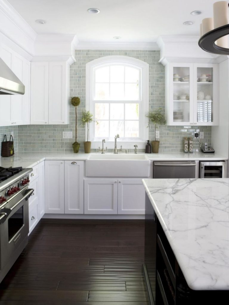 Cottage Style Kitchen with Calcutta Marble and a Farmhouse Sink www.PattersonDecoratingGroup.com/blog