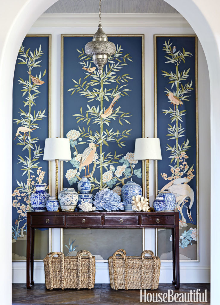 Entryway with custom panels and blue and white porcelain on an 1880s console Blue Rooms www.PattersonDecoratingGroup.com/blog