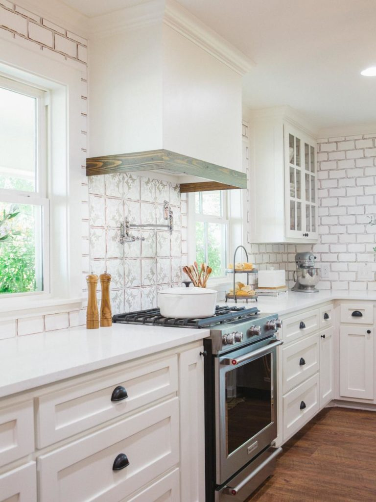 Fixer Upper Worm House Kitchen features white cabinetry subway tile and countertops while the wood & Fixer Upper Kitchens - Season 4 - Patterson Decorating Group ...