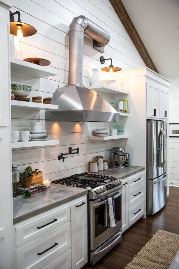 Fixer Upper Kitchen With An Feel Features A Stainless Vent Hood Open Shelving And