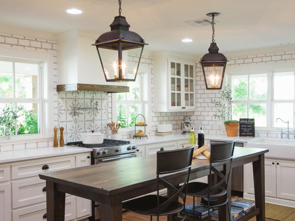 A Pair Of Dark Metal Lantern Lights Accent The Freestanding Island In This Fixer Upper Kitchen